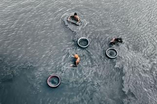 西貢河的工人